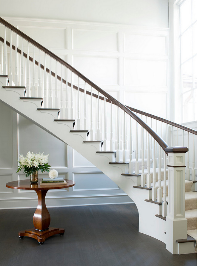 Classic White Staircase Wainscoting. Foyer